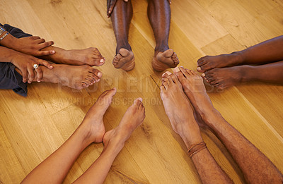 Buy stock photo Cropped shot of a group of sporty people sitting in a circle