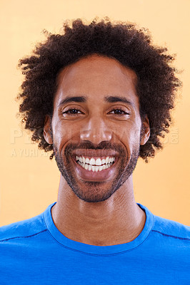 Buy stock photo A handsome young black man against a orange background