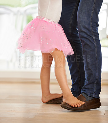 Buy stock photo Cropped shot of a little girl dancing with her father