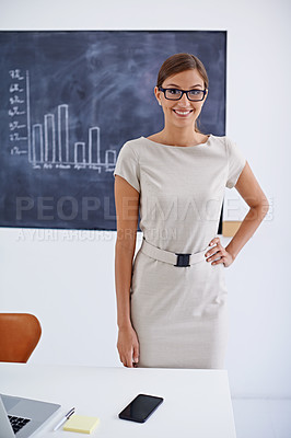 Buy stock photo Cropped shot of an attractive business woman standing behind a desk