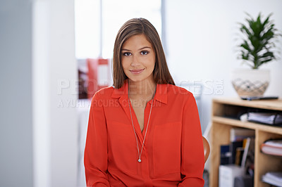 Buy stock photo Portrait of a beautiful young woman sitting in her office