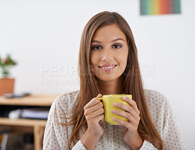Buy stock photo Portrait of a beautiful young woman holding a cup of coffe