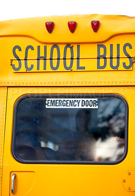 Buy stock photo The backside of a yellow school bus.