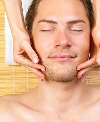 Buy stock photo Close up of a man receiving facial massage from a woman, while on holiday at the beauty spa