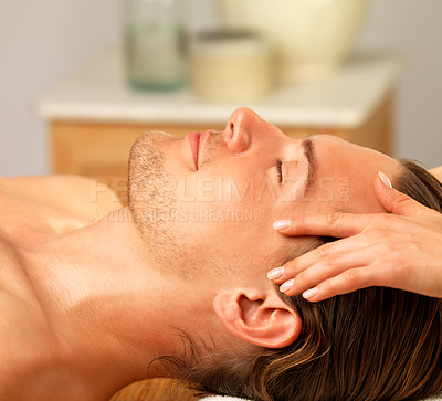 Buy stock photo Young happy man receiving facial massage. Enjoying a healthy holiday at the day spa.