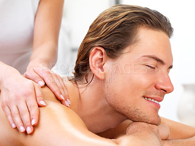 Buy stock photo Close up portrait of a young smiling man getting shoulder massage from masseuse