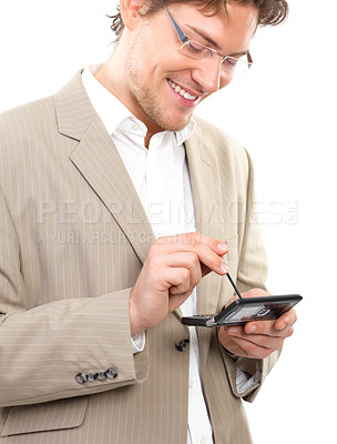 Buy stock photo Cheerful young businessman using mobile phone