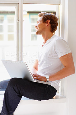 Buy stock photo A student taking a contemplative moment by his window. Light and simplistic surroundings.