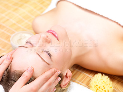 Buy stock photo Massaging a young woman at the beauty salon. Portrait of a pretty young girl getting a massage at the day spa