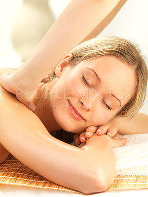 Buy stock photo Beautiful blond woman getting a shoulder massage in a relaxing setting