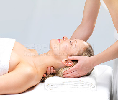 Buy stock photo Smiling girl getting a massage - hands massaging  - Portrait of a beautiful woman relaxing with a head massage at the day spa.