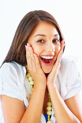 Buy stock photo Portrait of beautiful young girl holding her face in astonishment over white background