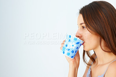 Buy stock photo Closeup of cute young girl having cup of coffee and looking at copyspace