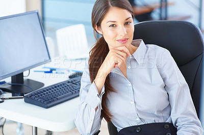Buy stock photo Portrait of young female executive sitting on an office chair and giving you warm smile