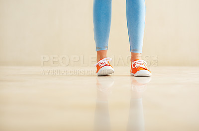 Buy stock photo Low section of girl in jeans and canvas shoes