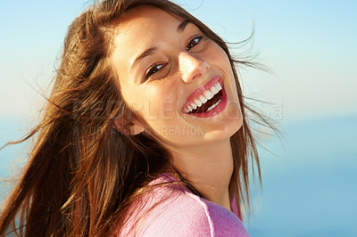 Buy stock photo Closeup of young girl giving you beautiful smile against sky
