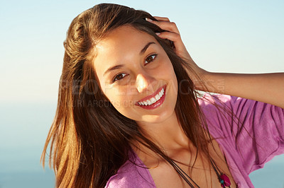 Buy stock photo Closeup of pretty young girl standing against sky and smiling