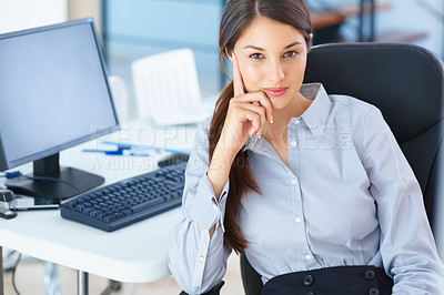 Buy stock photo Portrait of beautiful female executive sitting on an office chair and giving you warm smile
