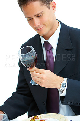 Buy stock photo Shot of a young man drinking wine in a restaurant