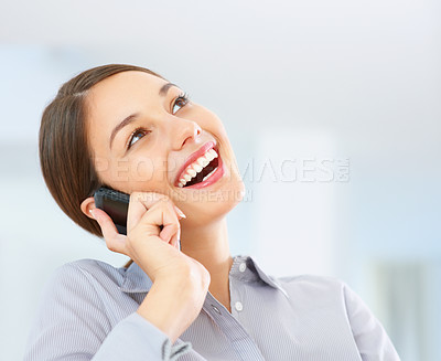Buy stock photo Closeup of cheerful business woman having friendly conversation on cellphone