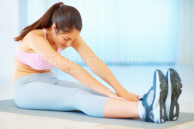Buy stock photo A fit young girl with feeling of relief after stretching her legs