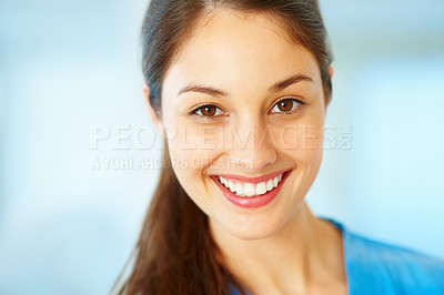Buy stock photo Closeup of beautiful young doctor giving you an attractive smile
