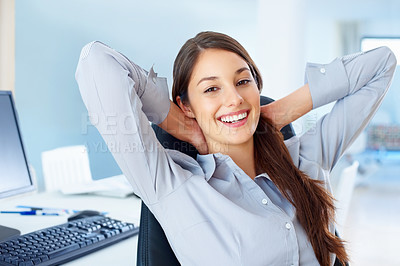 Buy stock photo Portrait of happy female executive sitting on office chair and relaxing with hands behind head