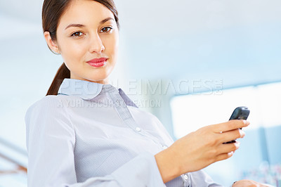 Buy stock photo Portrait of beautiful young female executive using cellphone