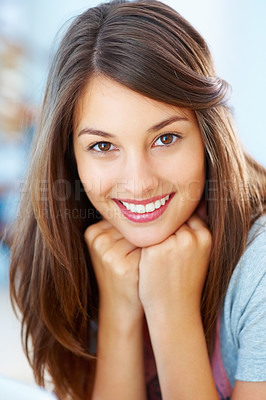 Buy stock photo Closeup of a naturally pretty girl with her hands on her chin smiling sweetly at you
