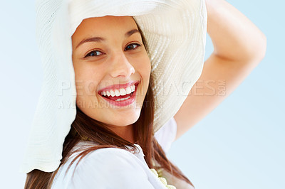 Buy stock photo Closeup of pretty young woman smiling while holding hat