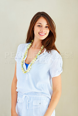 Buy stock photo Portrait of attractive young woman standing on plain background