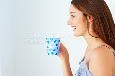 Buy stock photo Profile view of young woman having coffee and looking at copyspace