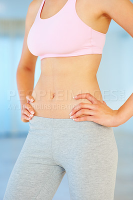 Buy stock photo Mid section of fitness young woman with hands on hips