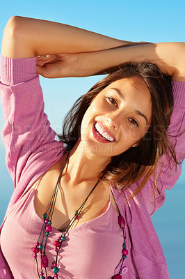 Buy stock photo Portrait of smiling young woman with hands on head