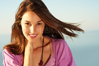 Buy stock photo Closeup of attractive young woman with wind in her hair - copyspace