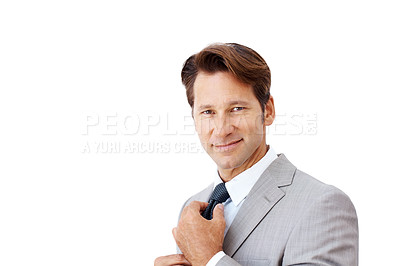 Buy stock photo Portrait of a smart young businessman fixing his necktie isolated against white background - Copyspace