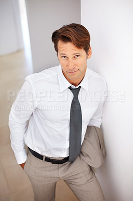 Buy stock photo Top view of a smart young businessman standing on staircase