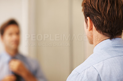 Buy stock photo Rear view of businessman adjusting necktie in front of mirror