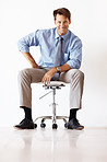 Successful young businessman sitting on the chair