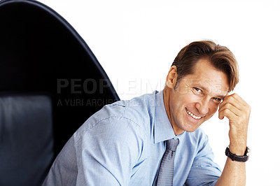 Buy stock photo Portrait of a smart young male entrepreneur sitting on chair against white background