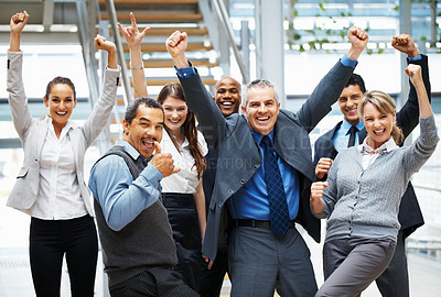 Buy stock photo Group of executives raising their arms in excitement
