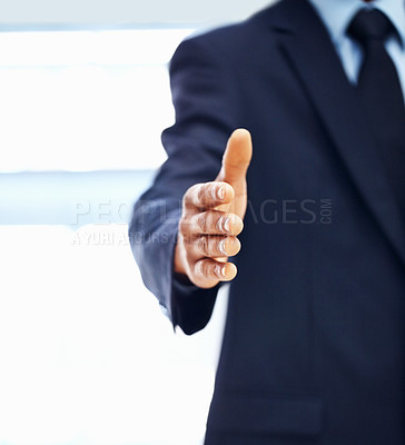 Buy stock photo View of executive extending hand to shake