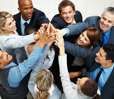Buy stock photo Group of executives placing their hands together