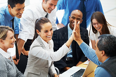 Buy stock photo Beautiful business woman high fiving colleague during meeting