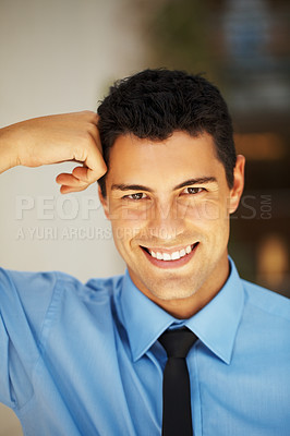 Buy stock photo Handsome executive leaning his head against fist
