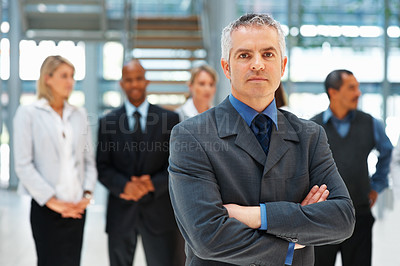 Buy stock photo Confident senior executive with arms crossed