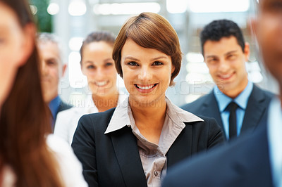 Buy stock photo Focus on businesswoman amongst colleagues