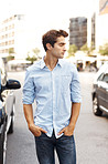 Young man standing outdoor looking away