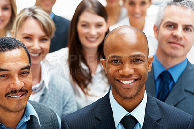 Buy stock photo Happy business man with smiling colleagues standing behind him