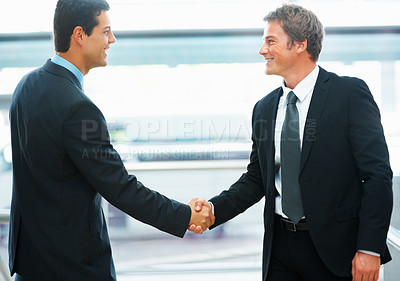 Buy stock photo Executives shaking hands and smiling